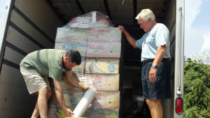 tony_and_ken_wrapping_pallat_for_shipment_to_ch.jpg